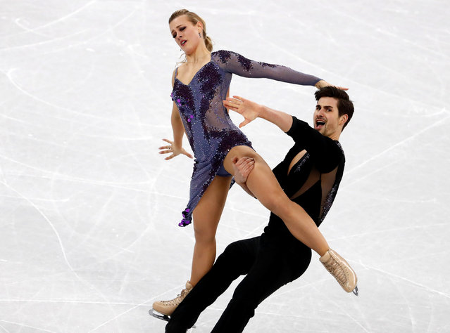 USA' s Madison Hubbell and USA' s Zachary Donohue compete in the ice dance short dance of the figure skating event during the Pyeongchang 2018 Winter Olympic Games at the Gangneung Ice Arena in Gangneung on February 19, 2018. (Photo by Damir Sagolj/Reuters)