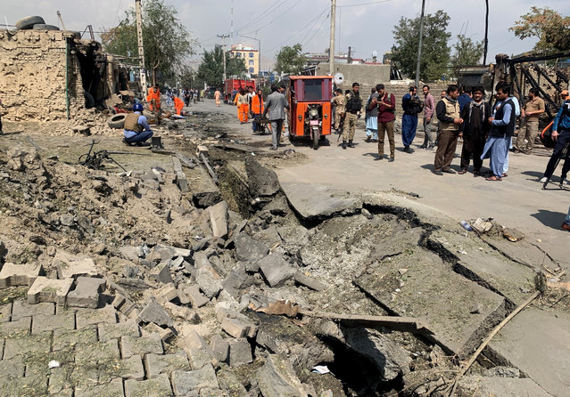 Afghan security personnel and Municipality workers work at the site of an explosion in Kabul, Afghanistan, Wednesday, September 9, 2020. Spokesman for Afghanistan's Interior Ministry said the bombing that targeted the convoy of the country's first vice president on Wednesday morning killed several people and wounded more than a dozen others, including several of the vice president's bodyguards.(Photo by Rahmat Gul/AP Photo)
