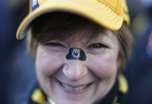 Hamilton Tiger Cats fan Kathy Stazyk arrives ahead of  the CFL's 102nd Grey Cup football championship between the Calgary Stampeders and the Tiger Cats in Vancouver, British Columbia, November 30, 2014. (Photo by Ben Nelms/Reuters)