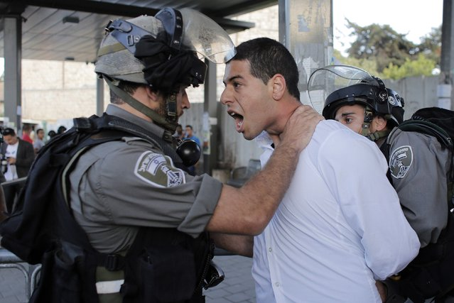 Israeli border policemen detain a Palestinian demonstrator during a protest near Damascus Gate in Jerusalem's Old City, in this June 5, 2014 file photo. (Photo by Ammar Awad/Reuters)