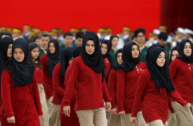 Students of an Imam Hatip high school march during a Republic Day ceremony in Ankara, Turkey, October 29, 2015. (Photo by Umit Bektas/Reuters)
