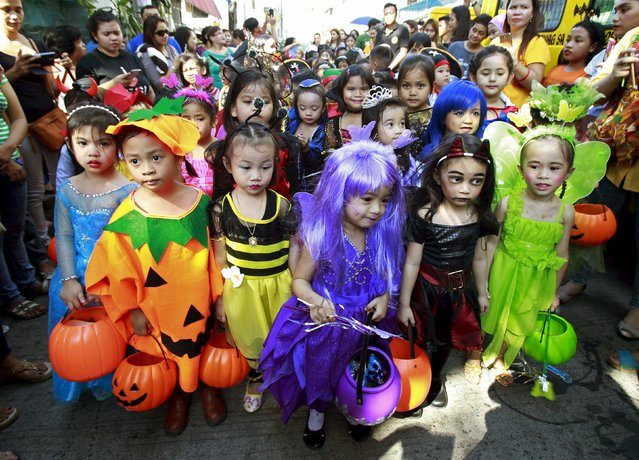 Students of Brainshire Science School wear costumes as they participate in a halloween parade in Paranaque city, metro Manila October 30, 2015. (Photo by Romeo Ranoco/Reuters)