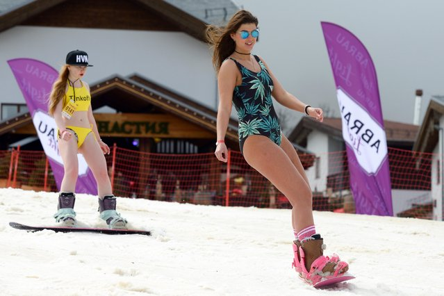 Girls in swimsuits participate in the BoogelWoogel alpine carnival at the Rosa Khutor Alpine Resort in Krasnaya Polyana, Sochi, Russia on March 31, 2018. (Photo by Artur Lebedev/TASS)