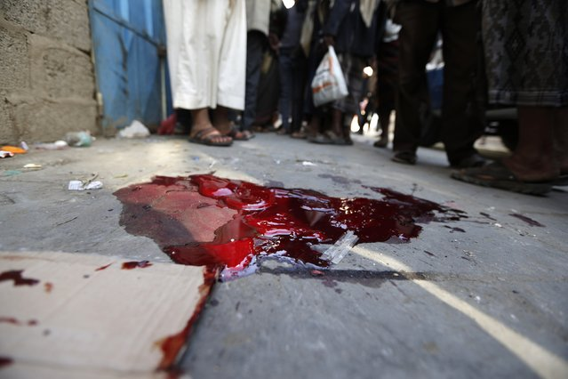 Blood stains are seen at the scene of an assassination of Faisal al-Sharif, a tribal chieftain loyal to the Shi'ite Houthi group, in Sanaa December 23, 2014. Al-Sharif was gunned down in a drive-by shooting, local media reported. (Photo by Khaled Abdullah/Reuters)