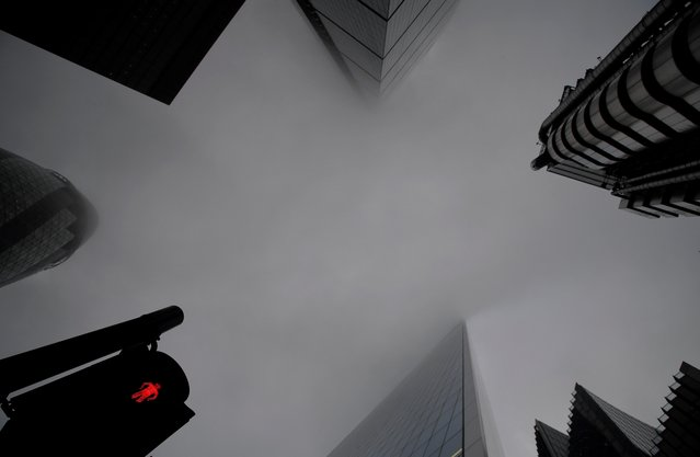 Skyscrapers in the City of London financial district are seen on a foggy morning, amid the spread of the coronavirus disease (COVID-19), London, Britain, December 7, 2020. (Photo by Toby Melville/Reuters)
