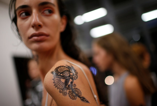 A model shows her temporary tattoo backstage at the Tbilisi Fashion Week in Tbilisi, Georgia, October 21, 2016. (Photo by David Mdzinarishvili/Reuters)