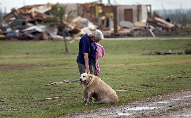Kay Taylor stands with her dog Bailey in front of her destroyed house in Oklahoma City on Monday. (Photo by Chris Landsberger/The Oklahoman)