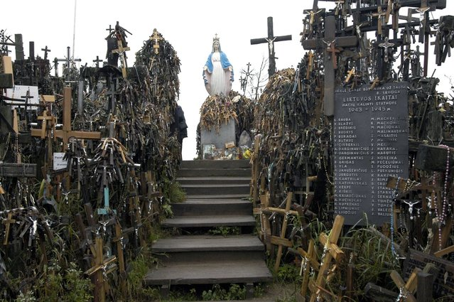 KGB agents were stationed at the site when crosses continued to appear. (Photo by Richard Gardner/Rex USA)