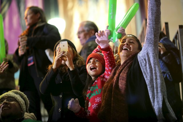 People cheer at the 84th Annual Hollywood Christmas Parade in the Hollywood section of Los Angeles, California, November 29, 2015. (Photo by David McNew/Reuters)
