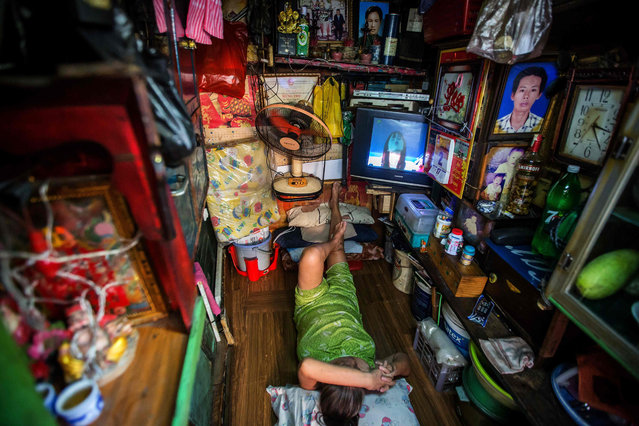 Kha Tu Ngoc rests in her two- square- meter house in Ho Chi Minh City on May 2, 2018. (Photo by Thanh Nguyen/AFP Photo)