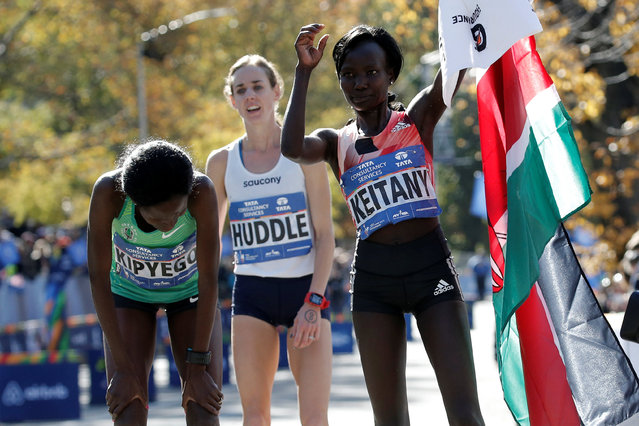 Winner Mary Keitany of Kenya (R), 2nd place finisher Sally Kipyego of Kenya (L) and third place finisher Molly Huddle of the U.S. stand at the finish line after the 2016 New York City Marathon in Central Park in the Manhattan borough of New York City, NY, U.S. November 6, 2016. (Photo by Mike Segar/Reuters)
