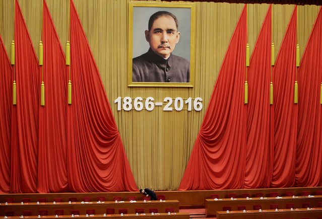 An attendant checks seats after a conference commemorating the 150th birth anniversary of Sun Yat-Sen, widely recognised as the father of modern China, at the Great Hall of the People  in Beijing, China, November 11, 2016. (Photo by Jason Lee/Reuters)