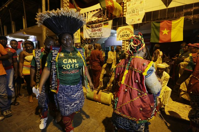 Cameroon soccer supporters dance on the street ahead of Cameroon soccer  national  team Group D Match on Saturday against Guinea at Estadio De Malabo in Malabo, Equatorial Guinea, Friday, January 23, 2015. (Photo by Sunday Alamba/AP Photo)