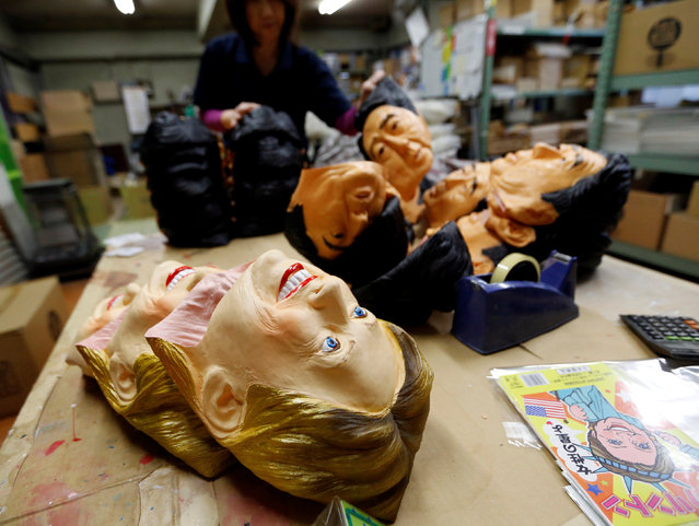 Rubber masks depicting Hillary Clinton (front) and Japan's Prime Minister Shinzo Abe are seen at the Ogawa Studios, a mask making company, in Saitama, Japan, November 21, 2016. (Photo by Toru Hanai/Reuters)