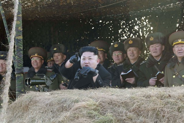 North Korean leader Kim Jong Un (front) watches a drill by the Korean People's Army (KPA) for hitting enemy naval target at undisclosed location in this undated photo released by North Korea's Korean Central News Agency (KCNA) in Pyongyang January 31, 2015. (Photo by Reuters/KCNA)