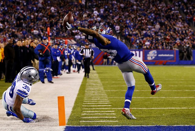 Al Bello, a U.S. photographer of Getty Images, won the Second Prize in the Sports Category, Singles, of the 2015 World Press Photo contest with this picture of Odell Beckham (#13) of the New York Giants making a one-handed touchdown catch in the second quarter against the Dallas Cowboys at MetLife Stadium in East Rutherford, New Jersey, in this picture taken November 23, 2014 and released by the World Press Photo on February 12, 2015. (Photo by Al Bello/Gety Images/World Press Photo)