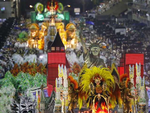 Revellers from the Mocidade samba school participate in the annual carnival parade in Rio de Janeiro's Sambadrome, February 16, 2015. (Photo by Ricardo Moraes/Reuters)