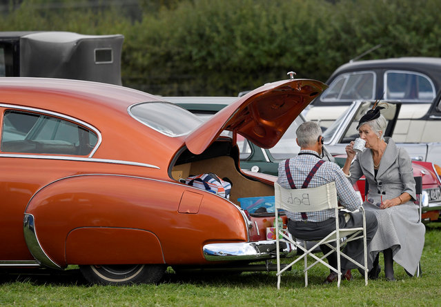 Motoring enthusiasts attend the Goodwood Revival, a three day classic car racing festival celebrating the mid-twentieth century heyday of the sport, at Goodwood in southern Britain on September 9, 2018. (Photo by Toby Melville/Reuters)