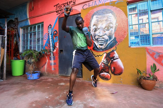 """Kenyan boxer and lawyer Shadrack Wambui, warms up during a training session with young boxers whom he trains in boxing and offers free legal advice, in Mathare slums, Nairobi, Kenya, 08 April 2021 (issued 16 April 2021). The NGO 'Sheria Mtaani-Na Shadrack Wambui' which means """"Law in the Streets"""" in Kiswahili, offers free legal advice and education on human rights for slum dwellers. Wambui, 30 years old and raised in the Mathare, founded the NGO with fellow lawyers and now blends boxing and law to offer free litigation to members of the community. (Photo by Daniel Irungu/EPA/EFE)"""