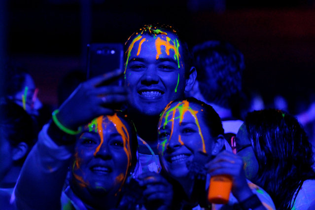 Participants take a selfie after a nocturnal 5K color glow party run in Monterrey, Mexico November 19, 2016. Picture taken on November 19, 2016. (Photo by Daniel Becerril/Reuters)