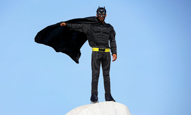 """27-year-old taxi driver Omer Efe Tektas, wearing """"Batman"""" costume, is seen in Mersin, Turkey on May 02, 2021. Tektas wanted to help his customers amid the novel type of the coronavirus (COVID-19) pandemic process and he starts to deliver the grocery shopping of the senior people who cannot leave their homes during the pandemic also gives presents to children. (Photo by Sezgin Pancar/Anadolu Agency via Getty Images)"""