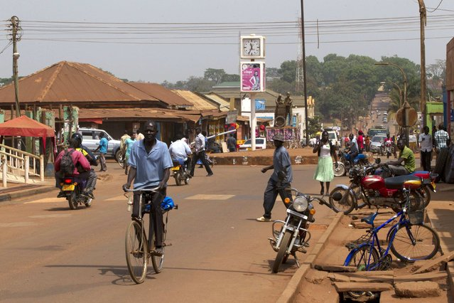 People walk in the main street in Gulu town, north of Uganda capital Kampala February 15, 2015. Picture taken February 15, 2015. (Photo by James Akena/Reuters)