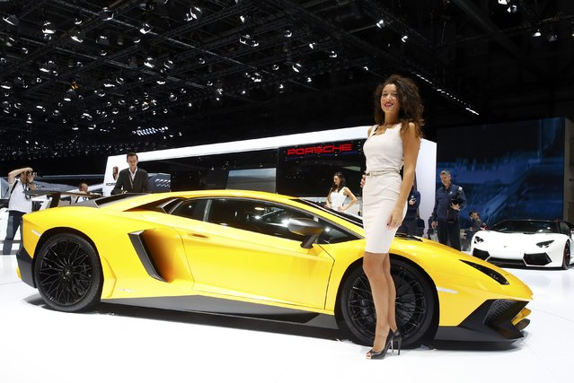 A model poses next to a Lamborghini Aventador SV sports car during the second press day ahead of the 85th International Motor Show in Geneva March 4, 2015.  REUTERS/Arnd Wiegmann