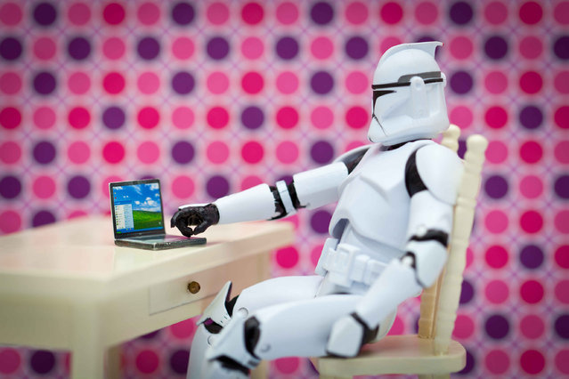 A storm trooper sits on its laptop, taken in Glasgow, Scotland, December 2016. (Photo by David Gilliver/Barcroft Images)