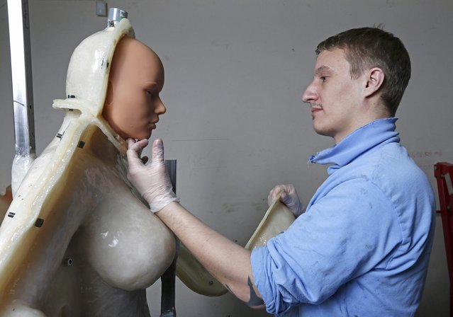 Eric, an employee at the Dreamdoll company, checks a silicone dream doll as he removes it from a mold at their workshop in Duppigheim near Strasbourg, February 18, 2015. (Photo by Vincent Kessler/Reuters)