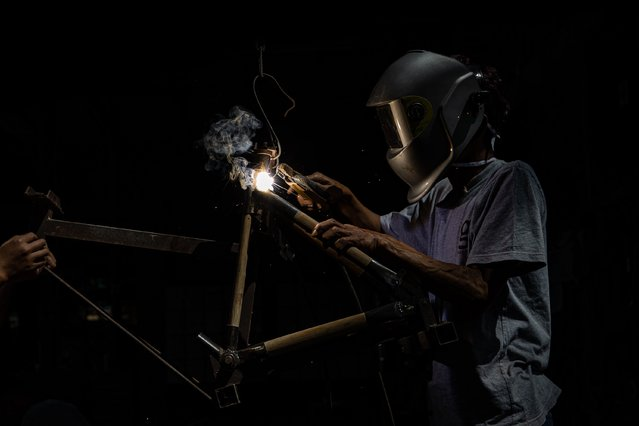 A worker welds Spedagi frame at Piranti Works workshop on June 02, 2021 in Temanggung, Indonesia. The Spedagi Bamboo Bike takes advantage of the light weight and durability of bamboo. It has the best vibration dampening characteristics for a bike and local materials are easy to get as bamboo grows very fast. The bike design uses giant bamboo (Dendrocalamus asper) for its abundance in the local area around the village, its large diameter, and its thick walls which makes it possible to create bicycle frame tubes of a uniform size. Singgih Susilo Kartono, Spedagi's creator, hopes not only to build a unique bike that uses natural materials, but to start a revitalization movement that he hopes will empower the village as a sustainable and self-sufficient community. Spedagi bikes are widely used in France, Japan, and large Indonesian cities such as Jakarta, where cycling is gaining popularity as an alternative to sitting in vehicles for hours on traffic-choked roads. Spedagi won the Bronze Award in Hong Kong DFA Design for Asia Awards 2017, the Japan Good Design Gold Award 2018, Excellent Product Design in German Design Award Special 2019, and has passed the vibration fatigue impact test by the Japan Vehicle Inspection Association (JVIA). (Photo by Robertus Pudyanto/Getty Images)