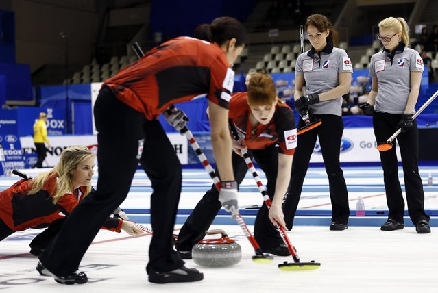 Russia's Ekaterina Galkina (2nd R) and Alexandra Saitova (R) watch Canada's skip Jennifer Jones (L), Dawn McEwen and Jill Officer (2nd L) during their curling round robin game at the World Women's Curling Championship in Sapporo March 16, 2015. (Photo by Thomas Peter/Reuters)