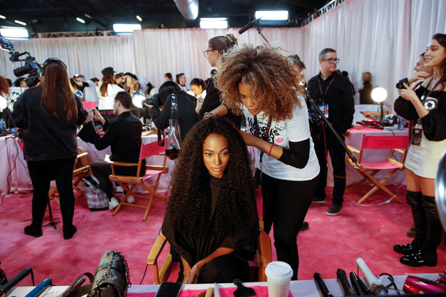 Melie Tiacoh is prepared backstage during the Victoria's Secret fashion show in the Manhattan borough of New York City, U.S., November 8, 2018. (Photo by Caitlin Ochs/Reuters)