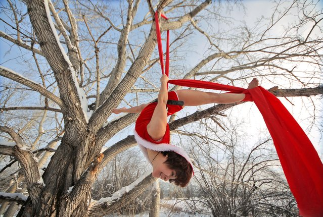 A dancer performs on a tree in temperatures below minus 37 degrees Celsius (minus 34.6 degrees Fahrenheit) in Mohe, Heilongjiang province, China, December 23, 2016. (Photo by Reuters/Stringer)