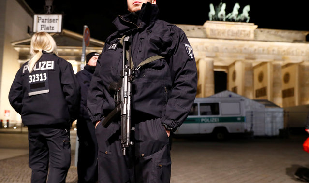 German police provide security at the Brandenburg Gate, ahead of the upcoming New Year's Eve celebrations in Berlin, Germany December 27, 2016. (Photo by Fabrizio Bensch/Reuters)