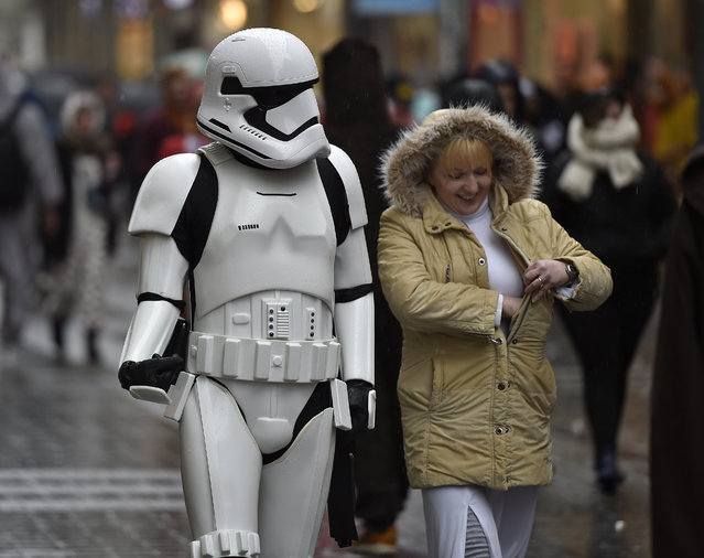 A reveler dressed  as a  storm trooper accompanies  a woman during the start of the street carnival in Cologne, Germany, on Thursday, February 4, 2016. (Photo by Martin Meissner/AP Photo)