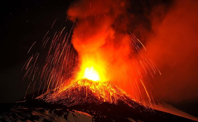 Mt. Etna spews lava during an eruption as seen from Acireale. (Photo by Carmelo Imbesi/Associated Press)