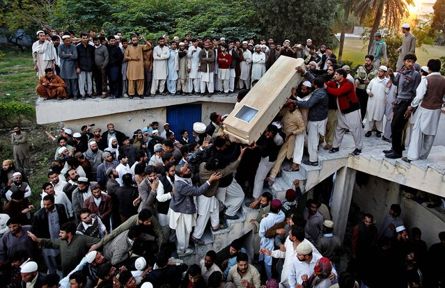 Sunni Muslims carry the casket of a victim killed in Friday's sectarian clashes during funeral prayers in Rawalpindi, Pakistan, on November 17, 2013. The Pakistani government imposed a rare curfew on Saturday in a northern city where sectarian clashes during a Shiite religious commemoration broke out the day before, while Taliban insurgents threatened to avenge the eight Sunni Muslims who authorities say were killed. (Photo by Anjum Naveed/Associated Press)