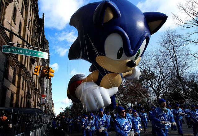 The Sonic the Hedgehog balloon makes it way down Central Park West. (Photo by Tina Fineberg/Associated Press)