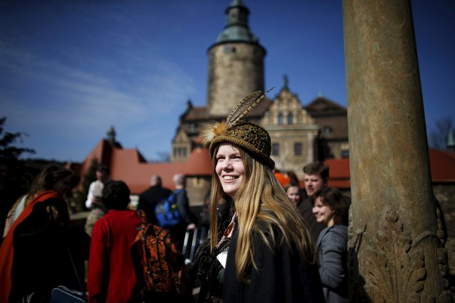 Stine Nielsen from Denmark smiles after arriving for the role play event at Czocha Castle in Sucha, west southern Poland April 9, 2015. (Photo by Kacper Pempel/Reuters)