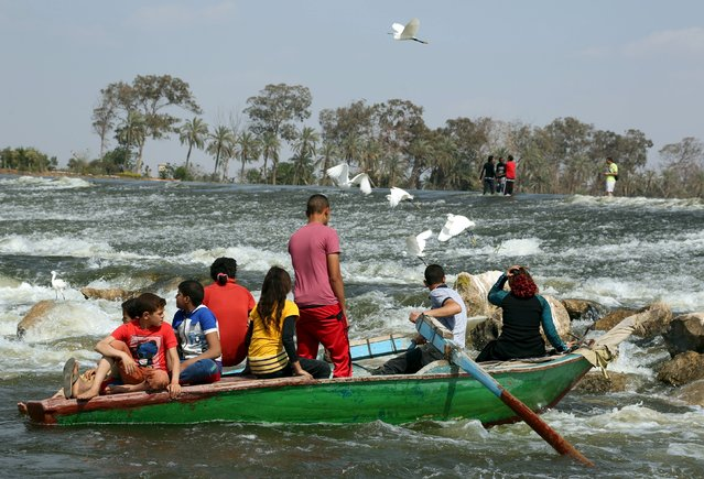 People take a cruise in a boat on the river Nile as they celebrate the spring holiday of Sham el Nessim on the outskirts of Cairo, April 13, 2015. (Photo by Asmaa Waguih/Reuters)