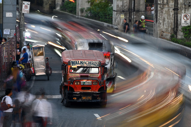 This picture taken on January 18, 2019 shows jeepneys during rush hour in Manila, Philippines. (Photo by Noel Celis/AFP Photo)