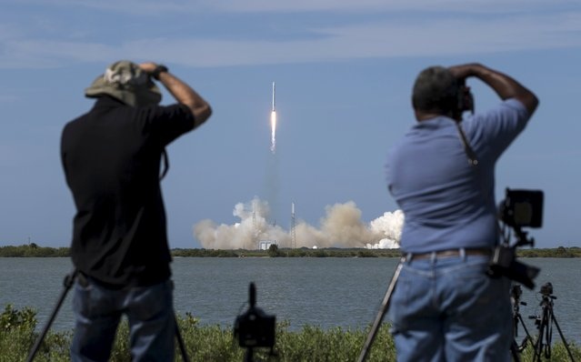 Photographers take pictures of the unmanned SpaceX Falcon 9 rocket with Dragon lifts off from launch pad 40 at the Cape Canaveral Air Force Station in Cape Canaveral, Florida April 14, 2015. (Photo by Scott Audette/Reuters)