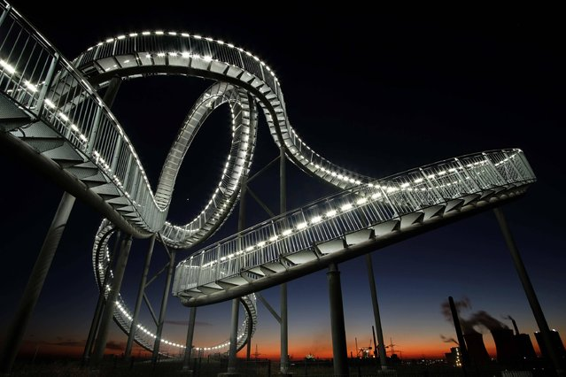 The sculpture Tiger and Turtle – Magic Mountain is pictured on January 19, 2017 in Duisburg, western Germany. (Photo by Kevin Kurek/AFP Photo/DPA)