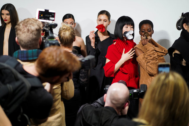Models pose backstage of the Marta Jakubowski show during London Fashion Week Women's A/W19 in London, Britain February 15, 2019. (Photo by Henry Nicholls/Reuters)