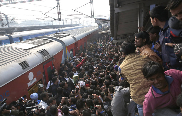 """Indian fans of the Bollywood actor Shahrukh Khan wait at the platform of the Hazrat Nizamuddin Railway Station as he was expected to arrive to promote his upcoming movie """"Raees"""" in New Delhi, India, 24 January 2017. Indian Bollywood actor Shahrukh Khan travelled from Mumbai to Delhi to promote his upcoming movie """"Raees"""" but did not show up in front his fans at Hazrat Nizamuddin Railway Station in Delhi as one his fans allegedly died at the Vadodara railway station due to heavy rush of his fans at the station. (Photo by Rajat Gupta/EPA)"""