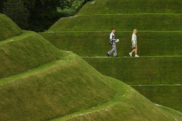 People are seen walking among the Cells of Life at Jupiter Artland Sculpture garden on June 8, 2021 in Edinburgh, United Kingdom. The Jupiter Artland Scupture Garden is an award-winning contemporary sculpture park founded by philanthropist art collectors Robert and Nicky Wilson, in 2009. Coronavirus lockdown easing across Scotland coupled with warm weather has seen visitors return to outdoor attractions. (Photo by Peter Summers/Getty Images)