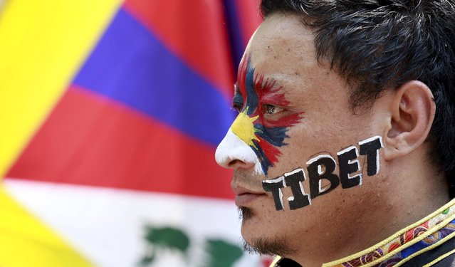 A Tibetan activist attends a protest held to mark the 57th anniversary of the Tibetan uprising against Chinese rule,  in New Delhi, India, March 10, 2016. (Photo by Cathal McNaughton/Reuters)