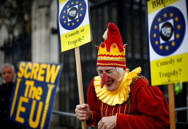 An anti-Brexit protester reacts next to a pro-Brexit protester in London, Britain, March 27, 2019. (Photo by Henry Nicholls/Reuters)