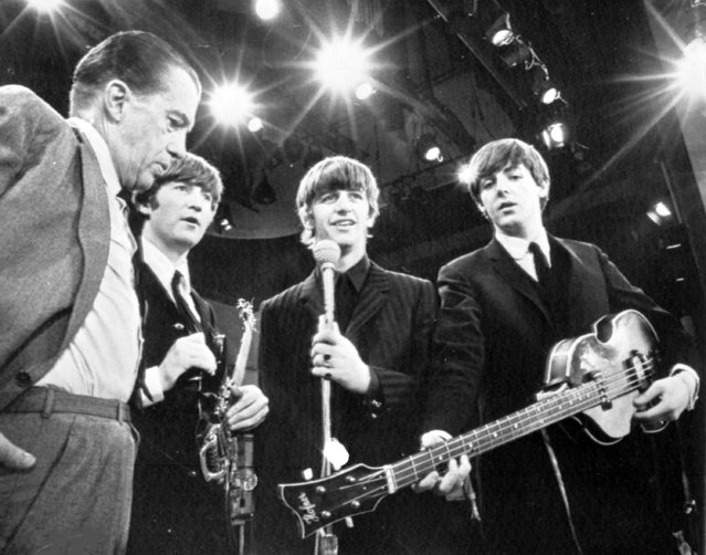 American TV host Ed Sullivan, left, talks with three members of the British pop group The Beatles during a rehearsal for their appearance on his TV show, in New York, February 8, 1964. From left, Sullivan, John Lennon, Ringo Starr and Paul McCartney. George Harrison, the fourth member of the group missed the rehearsal due to illness. (Photo by AP Photo)