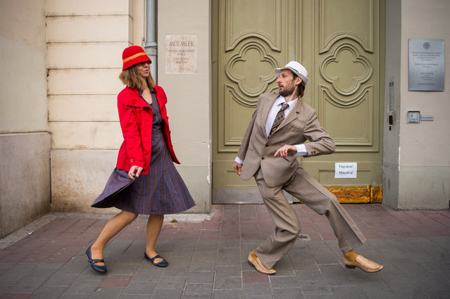 People perform during this year's flashmob of silly walks, based on the sketch from the television show Monty Python's Flying Circus by Monty Python troup, in Budapest, Hungary, 01 April 2019. (Photo by Zoltán Balogh/EPA/EFE)